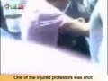 moving injured people in Al Kaboon-Damascus-Syria 15-07-2011.mpg
