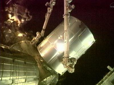 Raw Video: Storage bin loaded on space shuttle