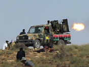 Anti-Qaddafi rebels struggle,  persevere