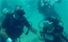 Mexican couple take the plunge with underwater wedding